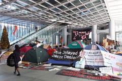 Hong Kong upptar protester som fördelas till Royaltyfri Foto