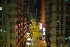 HONG KONG. Urban districts of Hong Kong at night. Skyscrapers, heavy dilapidated houses, all mixed up royalty free stock images