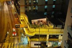 HONG KONG. Urban districts of Hong Kong at night. Skyscrapers, heavy dilapidated houses, all mixed up stock photography