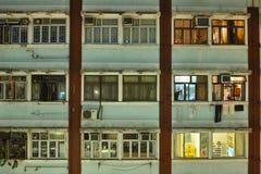 HONG KONG. Urban districts of Hong Kong at night. Skyscrapers, heavy dilapidated houses, all mixed up royalty free stock photo