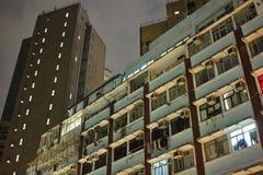 HONG KONG. Urban districts of Hong Kong at night. Skyscrapers, heavy dilapidated houses, all mixed up stock image