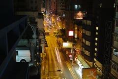 HONG KONG. Urban districts of Hong Kong at night. Skyscrapers, heavy dilapidated houses, all mixed up royalty free stock photography