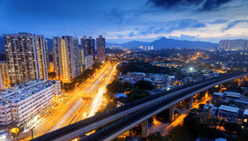 Hong kong urban downtown and high speed train at night Stock Photo