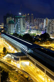 Hong kong urban downtown and high speed train at night Stock Photos