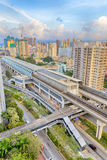 Hong kong urban downtown and sunset speed train Royalty Free Stock Photography