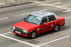 Hong Kong Urban röd taxi Fotografering för Bildbyråer