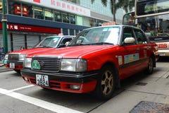 Hong Kong Urban röd taxi Arkivbilder