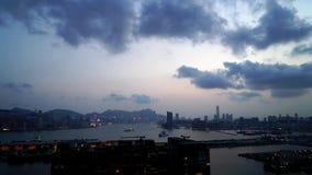 Hong Kong Victoria-baai van dag aan nacht stock videobeelden