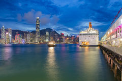 Hong Kong, Victoria Harbor and ferry pier. Victoria Harbour is a natural landform harbour situated between Hong Kong Island and Kowloon in Hong Kong. The Royalty Free Stock Photography