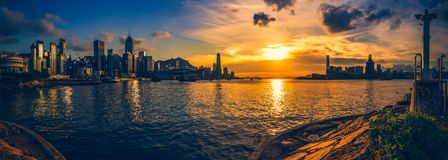 Hong Kong Victoria Harbor day and night Royalty Free Stock Photo
