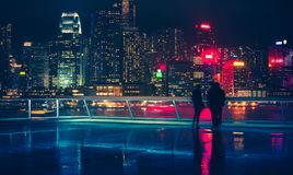 Hong Kong Victoria Harbor day and night Royalty Free Stock Photography