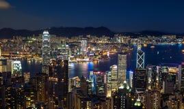 Hong Kong Victoria Harbor Skyline på natten Royaltyfria Bilder