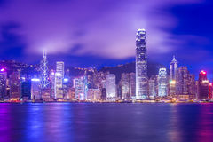 Hong Kong Victoria Harbour cityscape at night. Royalty Free Stock Images