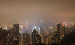 Hong Kong Victoria Harbour nattcityscape Arkivfoton