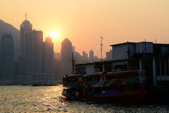 Hong Kong Victoria Harbour solnedgångsikt arkivfoto