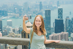 Hong Kong Victoria Peak woman taking selfie stick picture photo royalty free stock photos