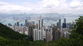 Hong Kong view. View over Hong Kong from Victoria peak showing a modern asian city with skyscrapers and harbour royalty free stock photos