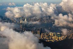 Hong Kong view with white clouds. A view of Hong Kong from the airplane window stock photos