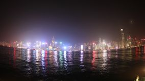 Hong Kong wide. Hong Kong fisheye wide time lapse of skyline with illuminated skyscrapers and red-sail junk boat at night. sea view stock video