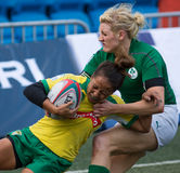Hong Kong Womens Sevens 2014. Hong Kong, China - March 28, 2014: Ireland player making tackle when playing against Brazil in the knockout stage of Hong Kong Royalty Free Stock Photography