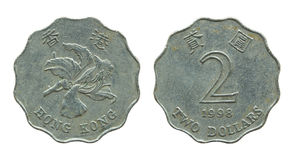 Hong Kong zwei Dollarmünzen lokalisiert auf Weiß Lizenzfreies Stockfoto