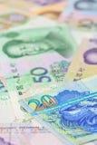 Hong- Kongdollar und -chinese Yuan-Banknoten, für Geldkonzept Stockbild