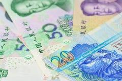 Hong- Kongdollar und -chinese Yuan-Banknoten, für Geldkonzept Stockfotos