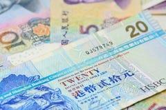 Hong- Kongdollar und -chinese Yuan-Banknoten, für Geldkonzept Stockbilder