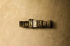 HONGARIJE - close-up van grungy wijnoogst gezet woord op metaalachtergrond Royalty-vrije Stock Foto
