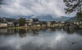 Hongcun village Anhui. Anhui  autumn  small bridge  china     overcast  pond  residence  small  hong village Stock Image