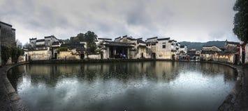 Hongcun village  moon pond. China  anhui  hong village  Residence  Architecture  autumn  overcast  pond  rain  moon pond Stock Photos