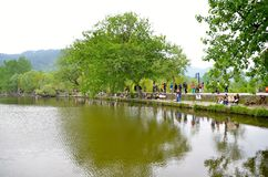 Hongcun Village River bank Artists Royalty Free Stock Photo