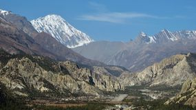 Hongde airport , limestone cliffs and snow capped Tilicho Peak Royalty Free Stock Image