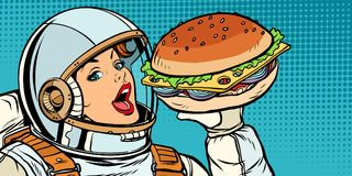 Hongerige vrouwenastronaut die Hamburger eten Stock Foto