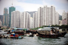 HongKong. A big and modern metropolis, with many skyscraper, but also many outmoded fishing boats stock photography