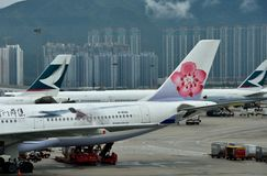 Hongkong Airport with airplane holding Royalty Free Stock Photos