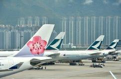 Hongkong Airport with many airplane holding Stock Photos