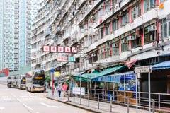 Street and Apartment in HongKong. Hongkong - April 21 2019 : Street and Apartment in daytime royalty free stock images