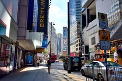 Hongkong Business center street. A sight of Hongkong center area street traffic, as buildings and bus, shown as city view and transportation, and people business Royalty Free Stock Photo