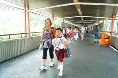 Hongkong, China: students go home from school Stock Photos