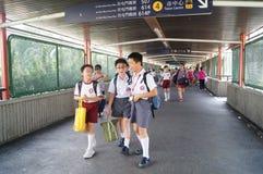 Hongkong, China: students go home from school Royalty Free Stock Photography