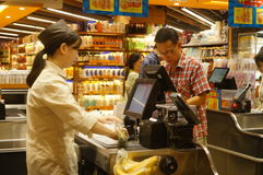 Hongkong, China: supermarket cashier checkout. Hongkong Tuen Mun, Cashier supermarket shopping checkout Royalty Free Stock Photos