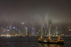 HONGKONG /CHINA 9TH MARS 2007 - den stadshorisonten och lightshowen Arkivfoton