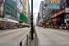 Hongkong commercial center shopping street. A sight of Hongkong center area street, as buildings and bus, shown as city view and transportation, and people Stock Images