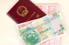 Hongkong dollar and Chinese passport. Chinese passport, Hong Kong dollars, stamps from Chinese and Hongkong borders Stock Photo