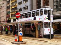 Hongkong Double-deck trolley car. Hongkong double deck streetcar on busy street in china Royalty Free Stock Photos