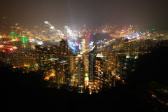 Hongkong island night time fulfill with light taking while exploding zoom len Royalty Free Stock Image