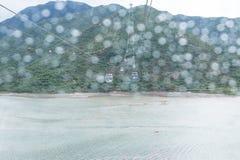 HONGKONG - Juli 7 th 2017: långdistans- kabelbil över Arkivfoto