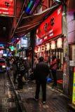 HONGKONG KINA - JANUARI, 17: Hong Kong uteliv Uteliv startar från 10 e.m., erbjuder en variation av stänger, shoppar och restaura Royaltyfria Foton