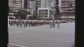 Scouts Marching Routine. HONGKONG, KOWLOON, MAY 1978. Many Scouts Standing At Attention In A Square By The Scout Association Of Hong Kong Headquarters, Training stock footage